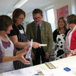 Explaining screen printing to visitors on an Open Day